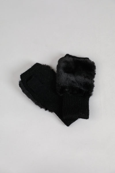 black mittens available at the white place, orange