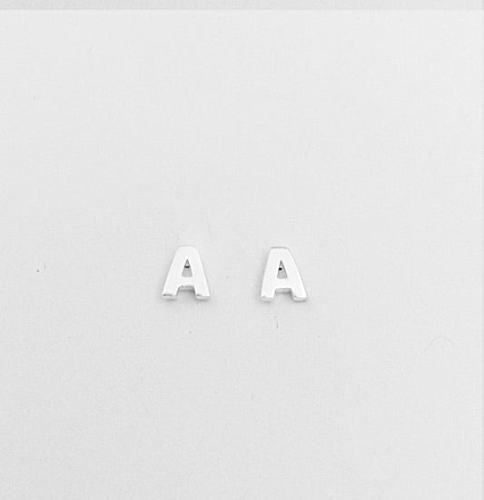 alphabet initial stud earrings available at the white place, orange