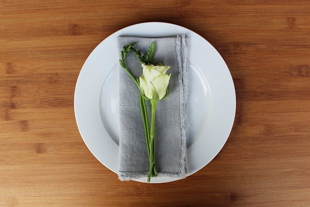 light grey linen napkin with raw frayed edge available for hire for wedding and events in orange and central west nsw from the white place lifestyle and events