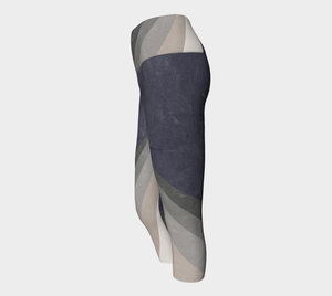 A color block design featuring shades of grey on these capri length leggings