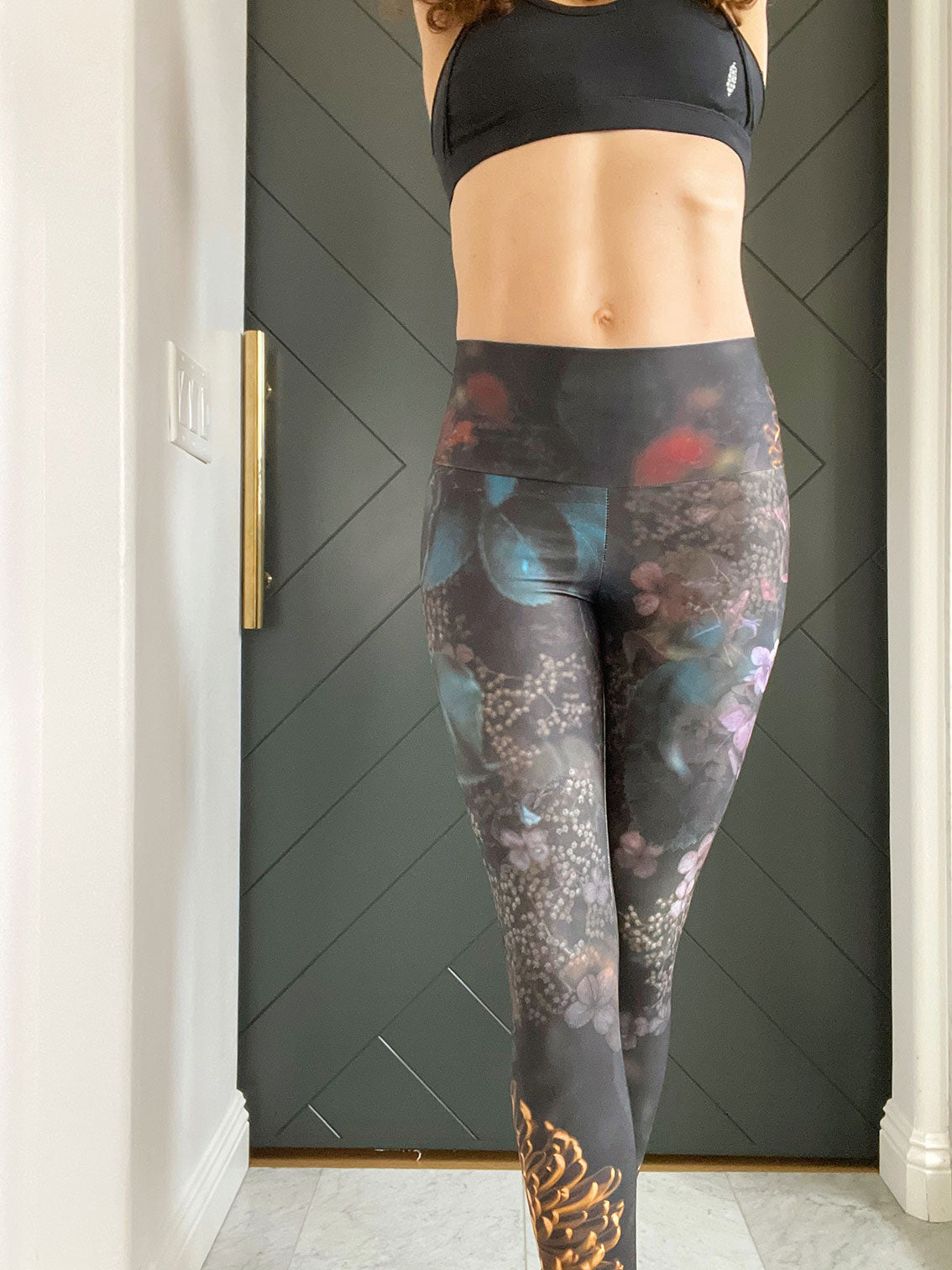Moody dark florals adorn these high-waisted compression  leggings