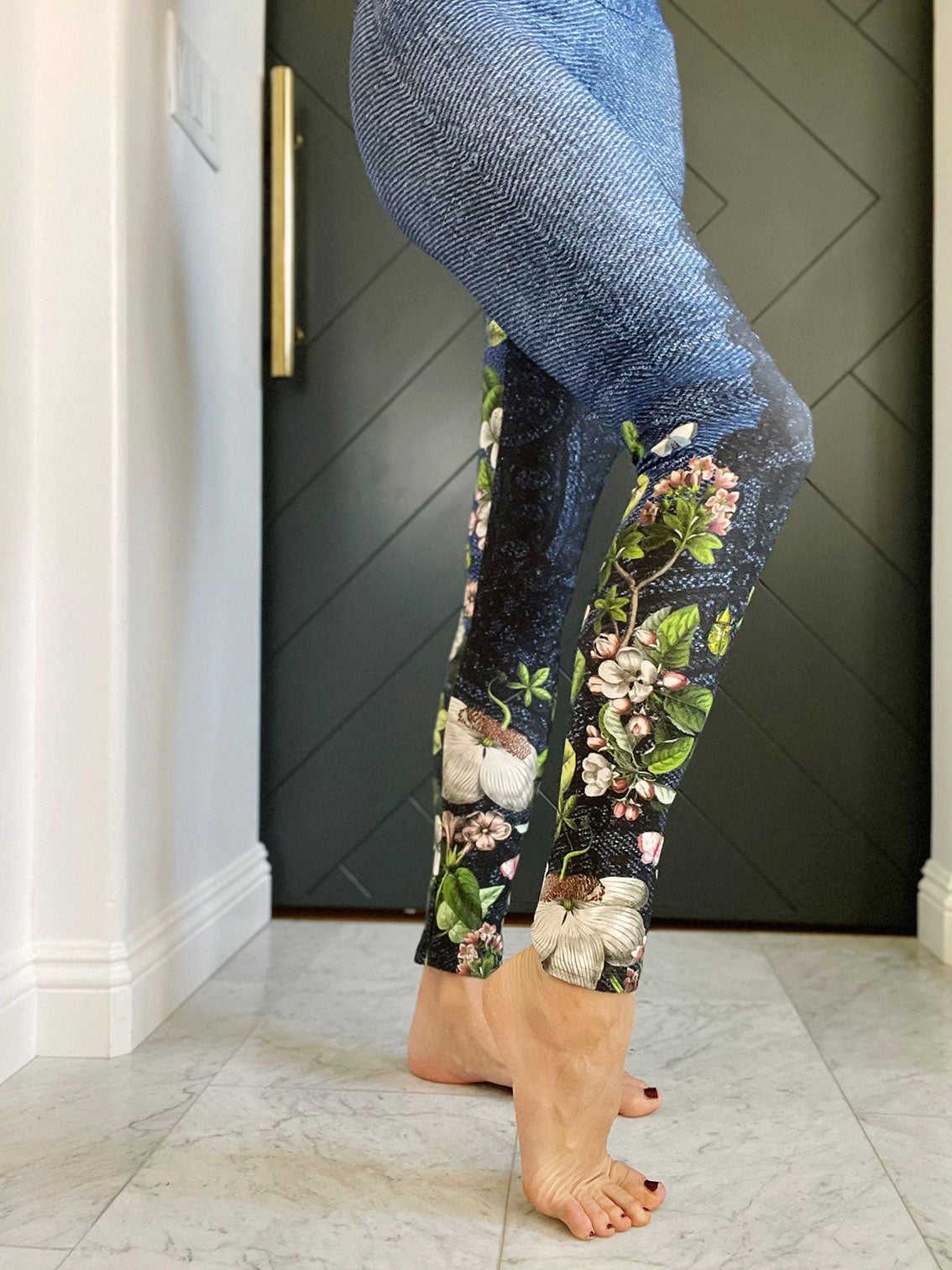 Sexy lace sits atop a dark denim backdrop with florals winding up the legs on these compression leggings