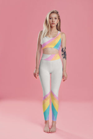 A color block style featuring a colorful rainbow adorn these compression leggings