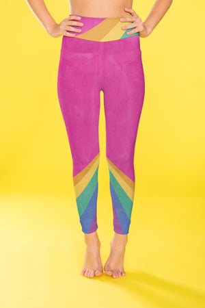 Rainbow color blocking against a bright pink backdrop on these compression leggings