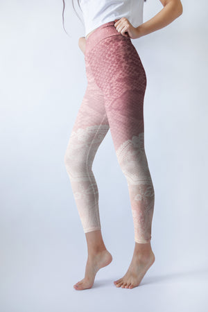 Pink hued snakeskin mingle with delicate lace on these high-waisted compression leggings