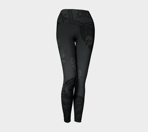 Delicate floral sketches mingle among subtle black lace for an unforgettable look on these compression leggings.