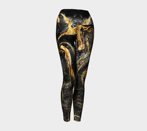 Black and Gold ethereal patterns evoke moon dust on these compression leggings.