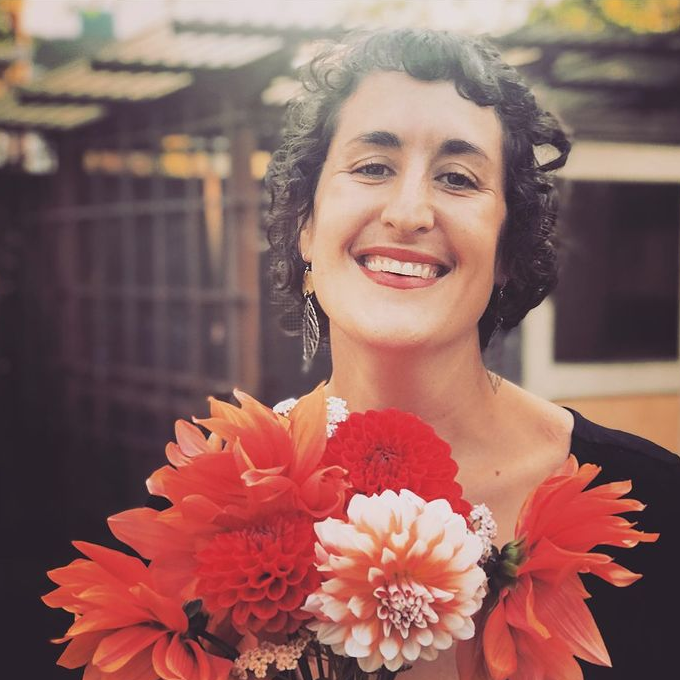 Gracie Schatz holding flowers and smiling
