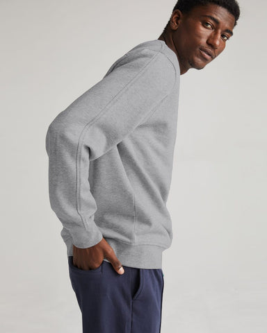 Classic Fit Crew Sweatshirt with Slightly Dropped Shoulder Seams for Comfortable Layering and a Back Yoke Detail.  Made from 60% Cotton, 40% Recycled Polyester, Richer Poorer, $72