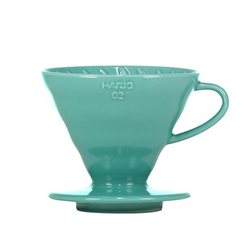 Turquoise Hario V60 Ceramic Dripper 02 is a must have coffee brewing equipment at home.