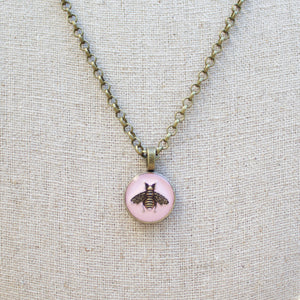 Repurposed Pink Gucci Bee Button necklace