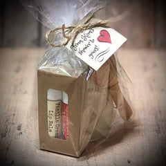 shower favor wrapped in cellophane bag with custom gift tag