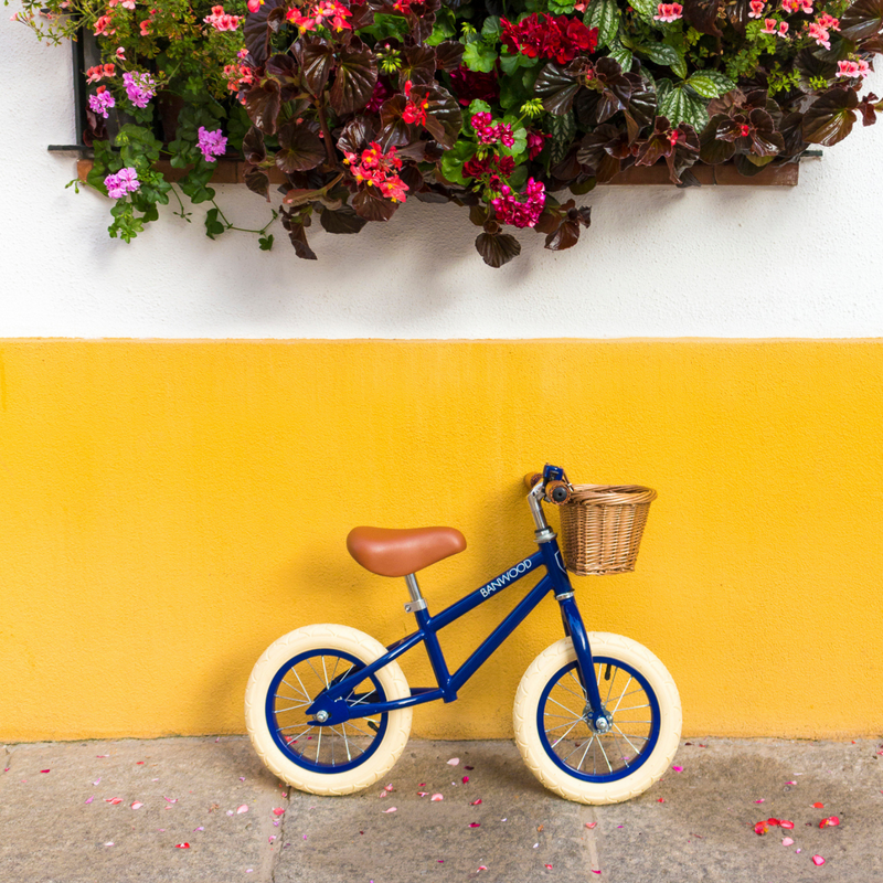 Bright coloured yellow background with navy blue banwood bike