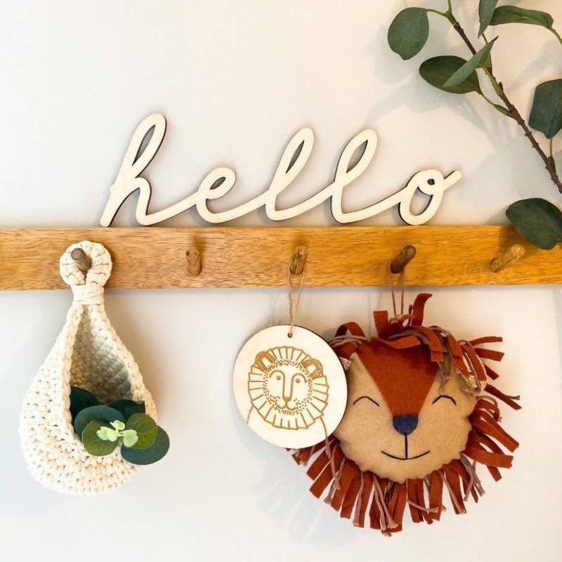 hello wooden sign on coat hanger