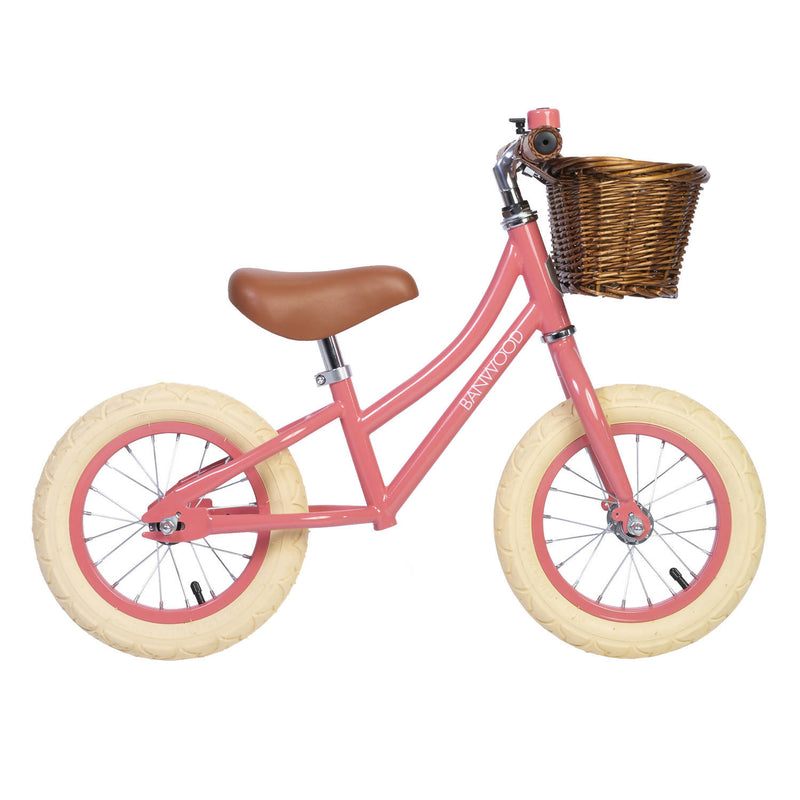 Coral Banwood bike with wicker basket and white wheels