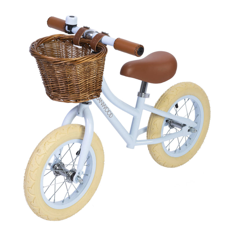 Sky Banwood bike with brown wicker basket and cream wheels
