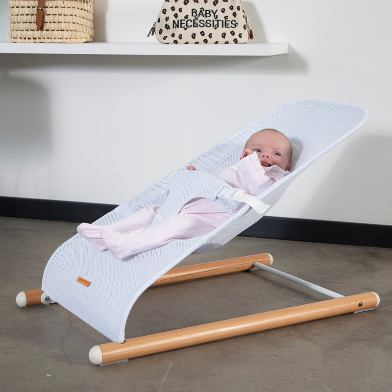 white baby bouncer with wooden legs
