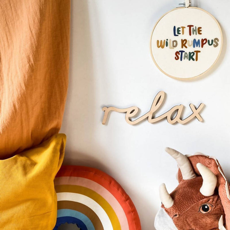 relax wooden word sign