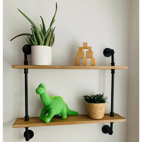 Green Knitted Diplodocus dinosaur on shelf with plants