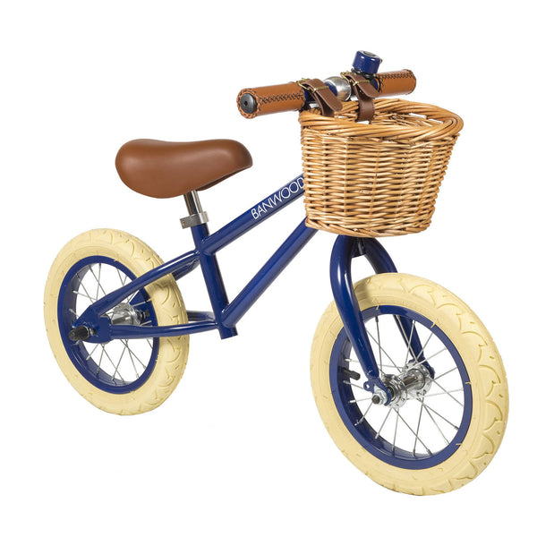 Navy Blue Banwood bike with brown wicker basket and cream wheels