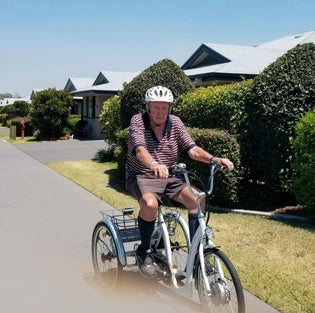 Mick Feely and his electric tricycle (76 years young)