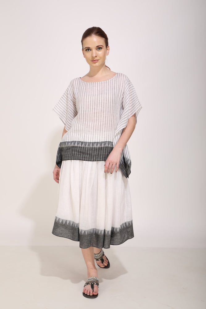 Ivory Caftan Top Paired With Pleated Skirt