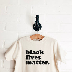 """Black Lives Matter."" Onesies + Child Tees"