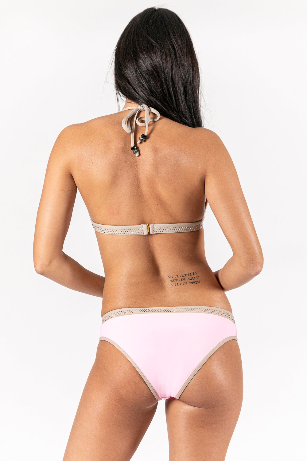Women bikini in color pink and nude with metal trimmings details . Sustainable Swimwear made from recycled plastics and bottles by BRISSUS