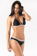 Women bikini in color black and nude with metal trimmings details . Sustainable Swimwear made from recycled plastics and bottles by BRISSUS