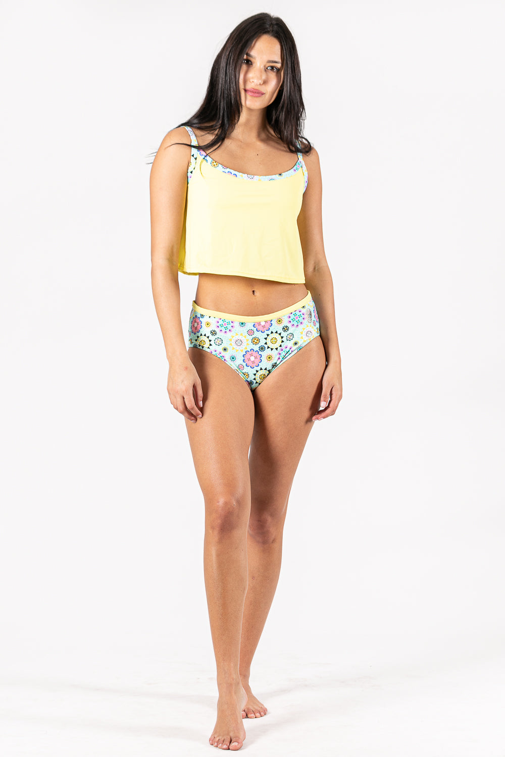 Two pieces tankini and supportive top. Flowering print  combine in yellow tones. Sustainable Swimwear made from recycled plastics and bottles by BRISSUS