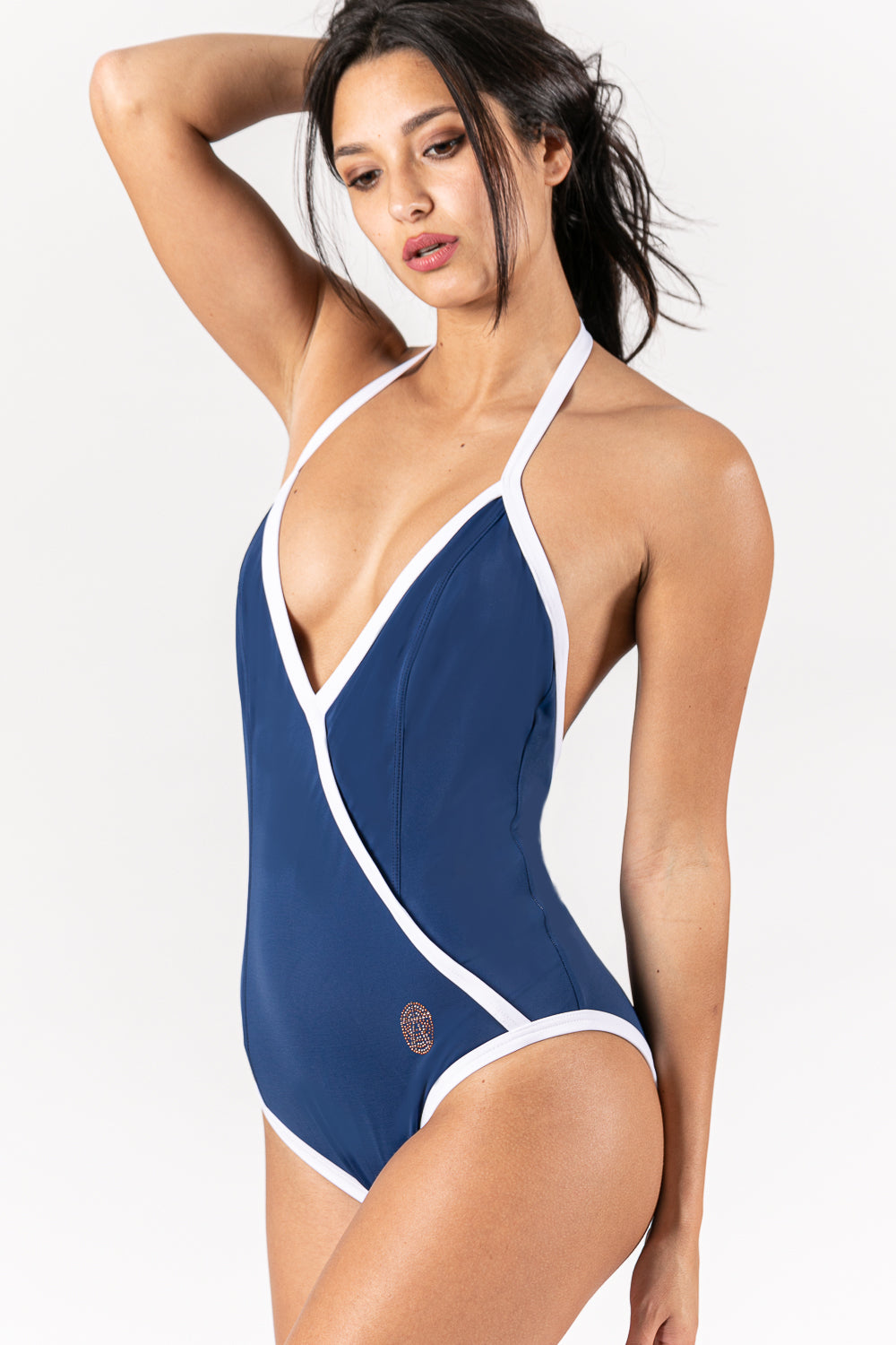 Women swimsuit in color blue marine with white trimmings.  Sustainable Swimwear made from recycled plastics and bottles by BRISSUS