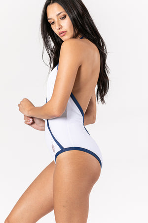 Women swimsuit in color white with blue marine trimmings.  Sustainable Swimwear made from recycled plastics and bottles by BRISSUS