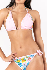 Women classical bikini in pink and tropical print combination. Sustainable Swimwear made from recycled plastics and bottles by BRISSUS