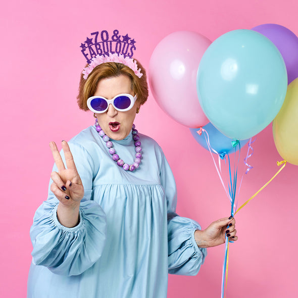 "Cool Grandma with colorful balloons wearing purple and light pink party crown saying ""70 & Fabulous"""