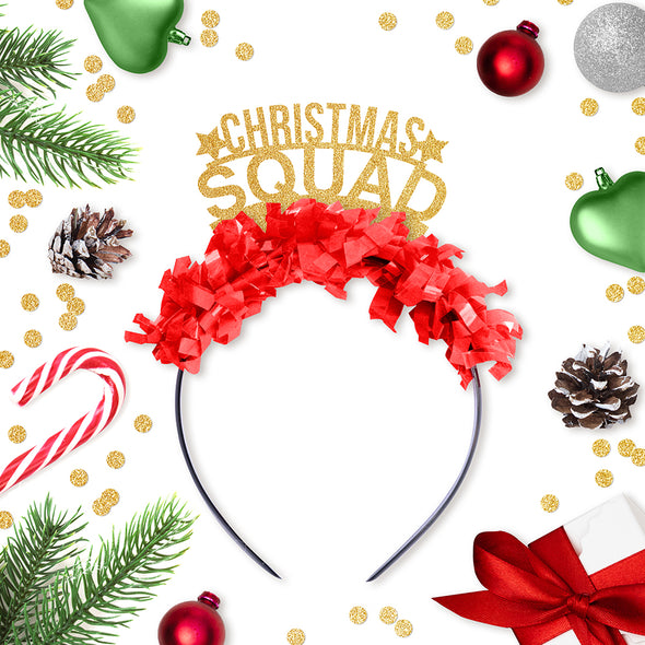 Gold party crown with red fringe saying Christmas Squad and has two little gold stars with holiday decorations surrounding it