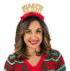 "Girl wearing a Christmas sweater and Gold glitter and red fringe party crown that says ""Happy Holidays"""