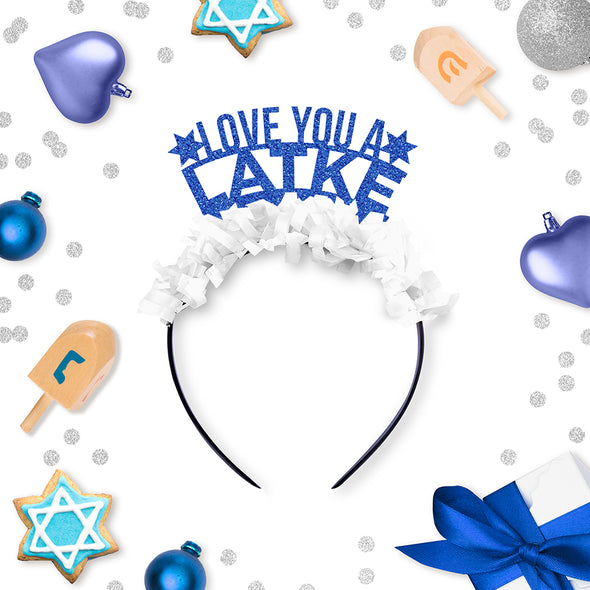 "Blue Glitter and White Fringe Party Crown that says ""Love You A Latke"" surrounded by Hanukkah Decorations"