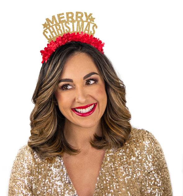 "girl wearing gold dress wearing a gold and red fringe party crown that says ""Merry Christmas"""