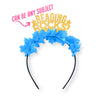 "Gold glitter and blue fringe party crown that says ""Reading Rocks!"" with star details"