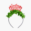 "Red glitter and green fringe party crown that says ""Santa's Favorite"" ""Santa's"" is in cursive"