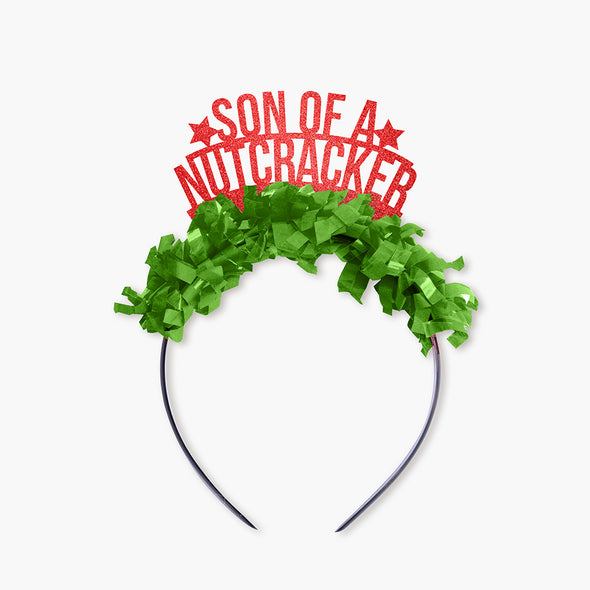 "Red glitter and green fringe party crown that says ""Son of A Nutcracker"" and has two stars"