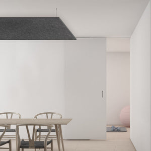 Suspended grey panels for indoor spaces