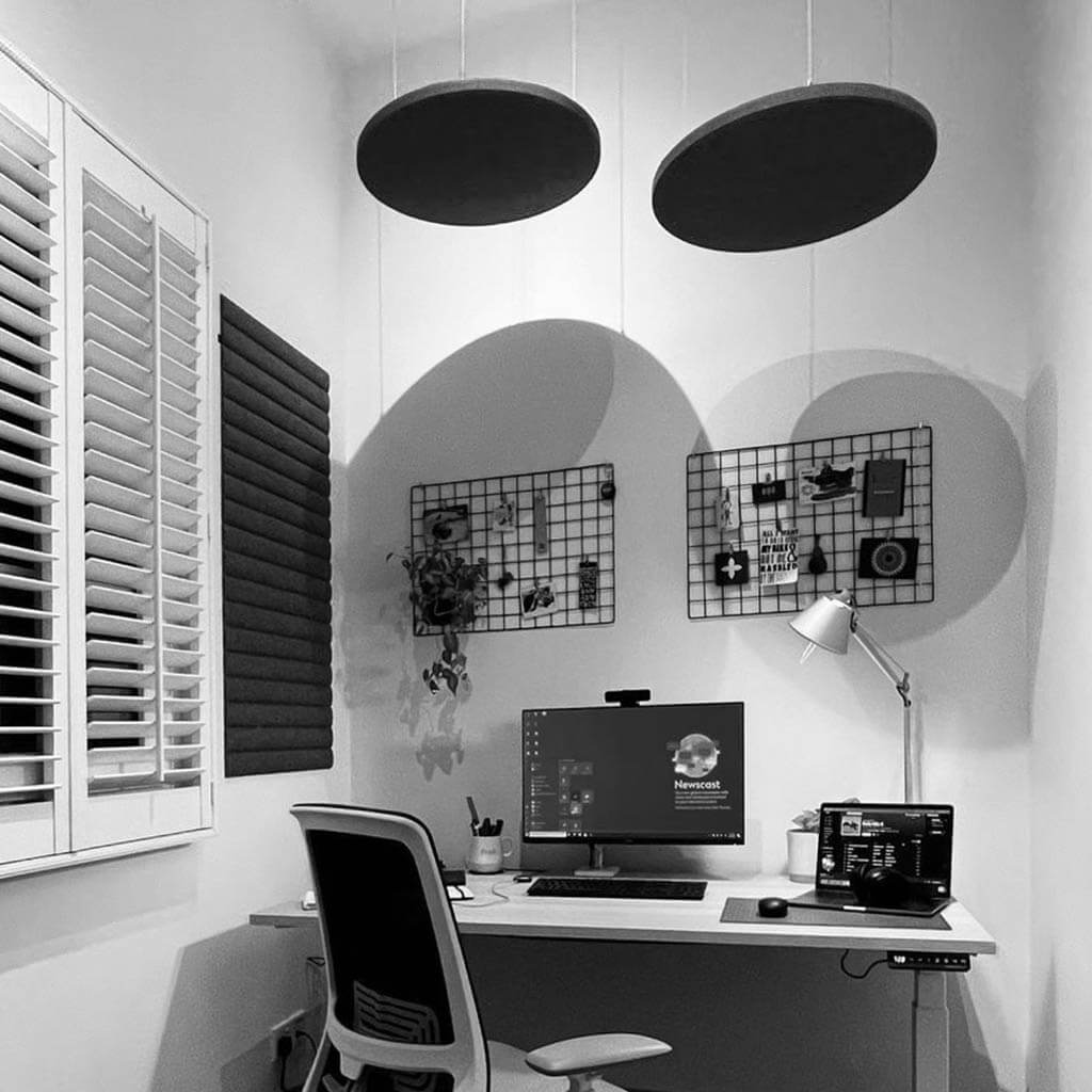 Home office with acoustic felt suspended from the ceiling and on the wall