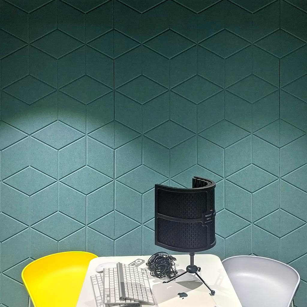 Sound recording studio with green carved felt panels on the wall