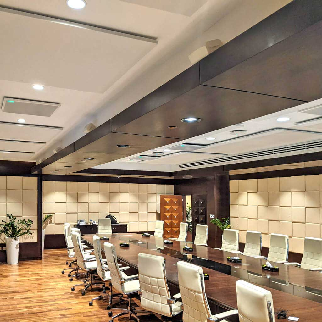 Conference room with suspended white ceiling felt panels