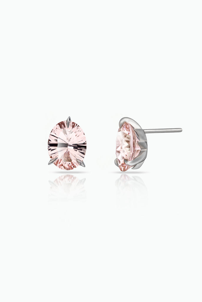 A modern take on a classic, solitaire stud earrings. The Morganite stones are Optix Cut, which gives a firework of delicate light within the stone. The stones are held in the Le Ster signature Fireburst setting. Each Earring is handcrafted in platinum. Designed for those who are drawn to understated detail.
