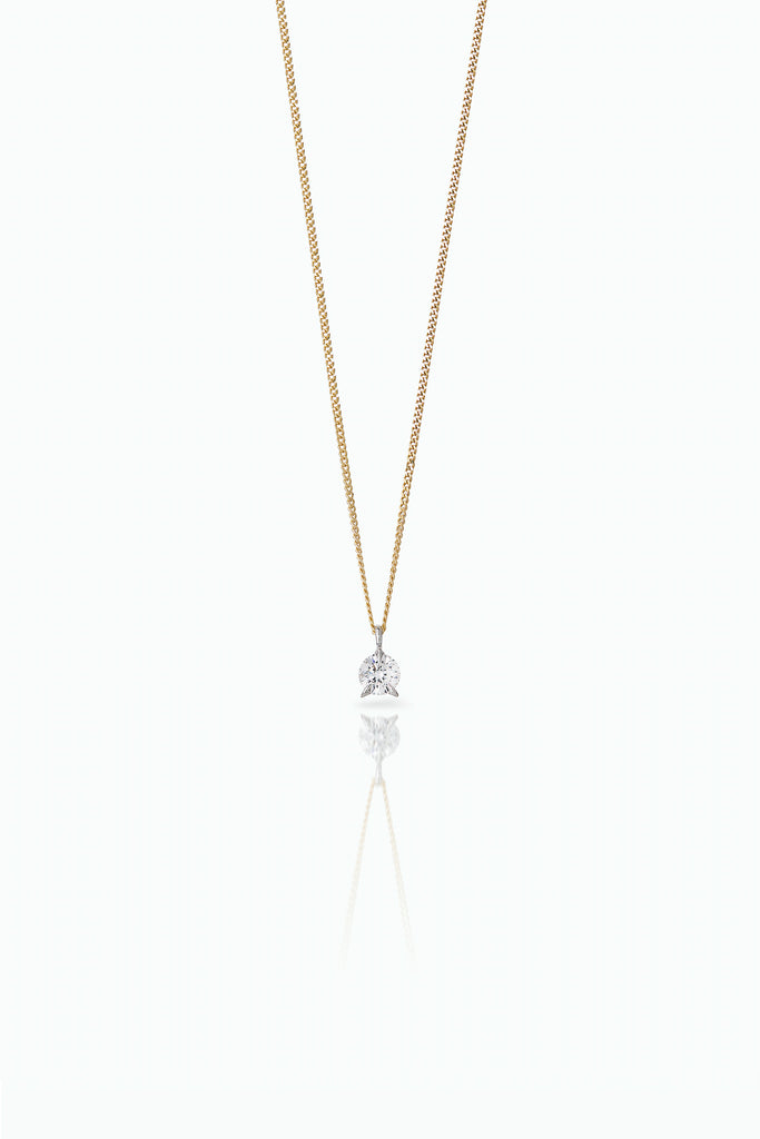 Bombette Diamond solitaire necklace. 18 Carat white gold with brilliant cut diamond. A modern take on a classic design, that lights up any day. Bought as a single or pair.
