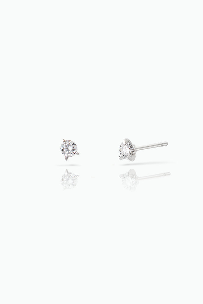 Bombette Diamonds Studs. 18 Carat white gold with brilliant cut diamonds. A modern take on a classic design, that lights up any day. Bought as a single or pair.