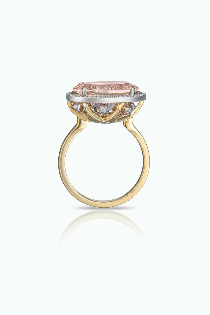 Kamuru; profile of large central morganite surround with pave set diamonds. The ring contains the Le Ster signature modern firework setting with diamonds and sapphire.