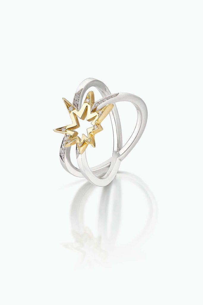Crossette, 18 Carat yellow gold and platinum ring; with double shank and modern firework design. Pave set diamonds. A statement day-in and day-out.